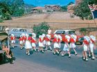 PRIDE ON SHOW: The Gladstone Harbour Festival Easter Parade in 1965; Red Cross girls marching past Our Lady Star of the Sea school grounds on Goondoon St.