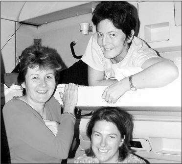 TOGETHERNESS: Ballina Country Labor branch president Sue Dakin, left, who was the driving force behind the protest train to Sydney, on board the XPT with Liberal MLC Catherine Cusack (top) and Nationals MLC Melinda Pavey (bottom).