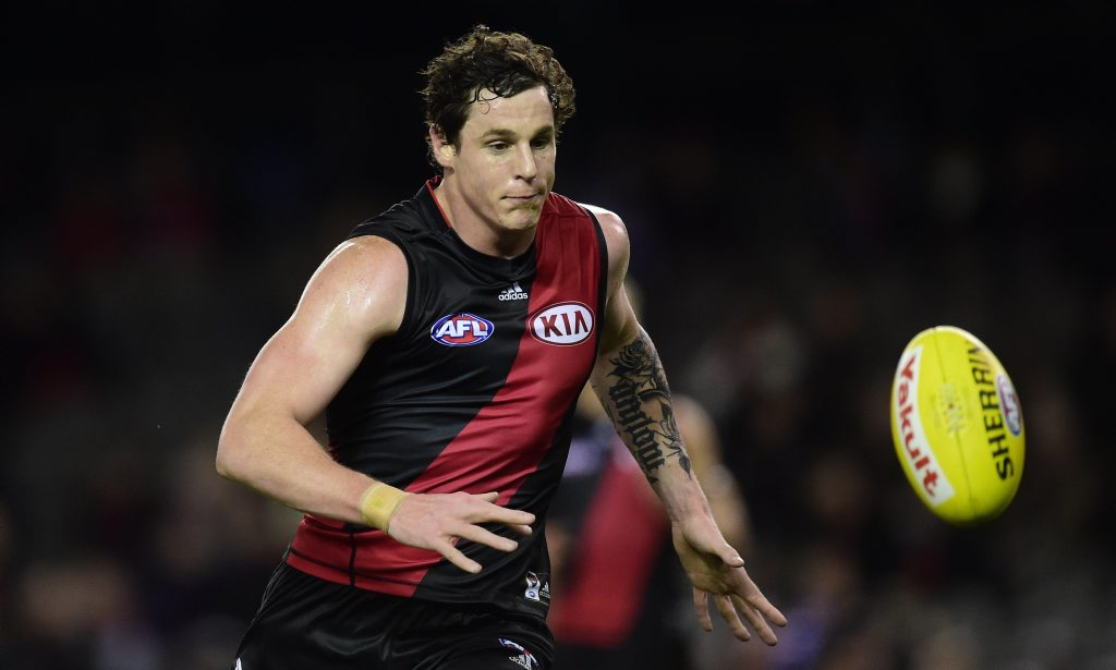 Essendon Bombers player Jake Carlisle chases the ball against the Western Bulldogs during round 18 of the AFL at Etihad Stadium in Melbourne, Sunday, Aug 2, 2015. (AAP Image/Julian Smith) NO ARCHIVING, EDITORIAL USE ONLY\