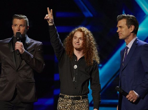 Eliminated X Factor contestant Jimmy Davis pictured with host Luke Jacobz, left, and mentor Chris Isaak.