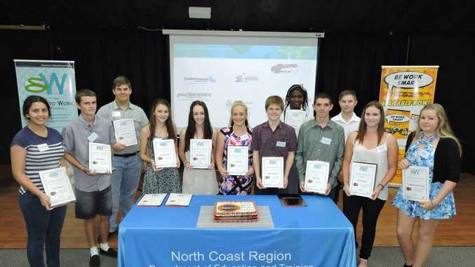 Graduates of the GenR8 program stand with program director for the North Coast region Mark Further.