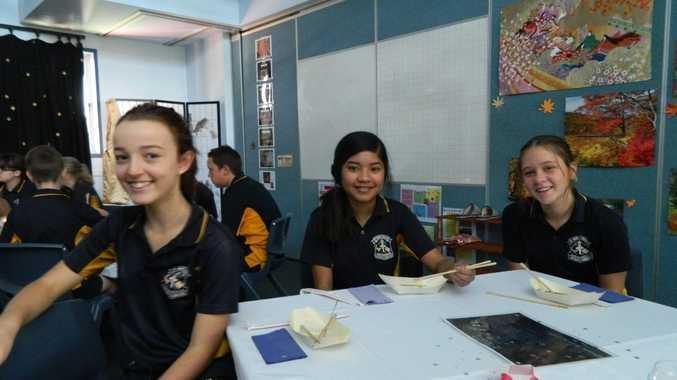 Brennah Goodall, Katrina Betiz and Leticia Fuller enjoy the celebrations of a Japanese cultural experience at school.