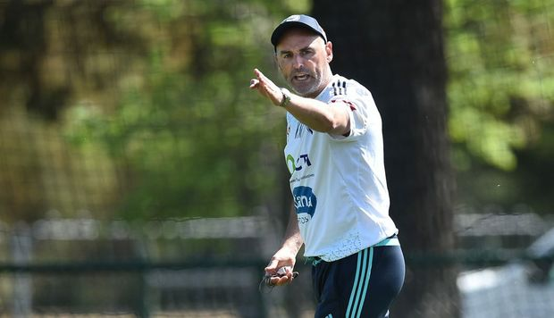 Melbourne Victory coach Kevin Muscat oversees training at Gosch's Paddock in Melbourne, Wednesday, Oct. 14, 2015. Vukovic breaks the Hyundai A-League games record this weekend when he plays his 229th game. (AAP Image/Julian Smith) NO ARCHIVING