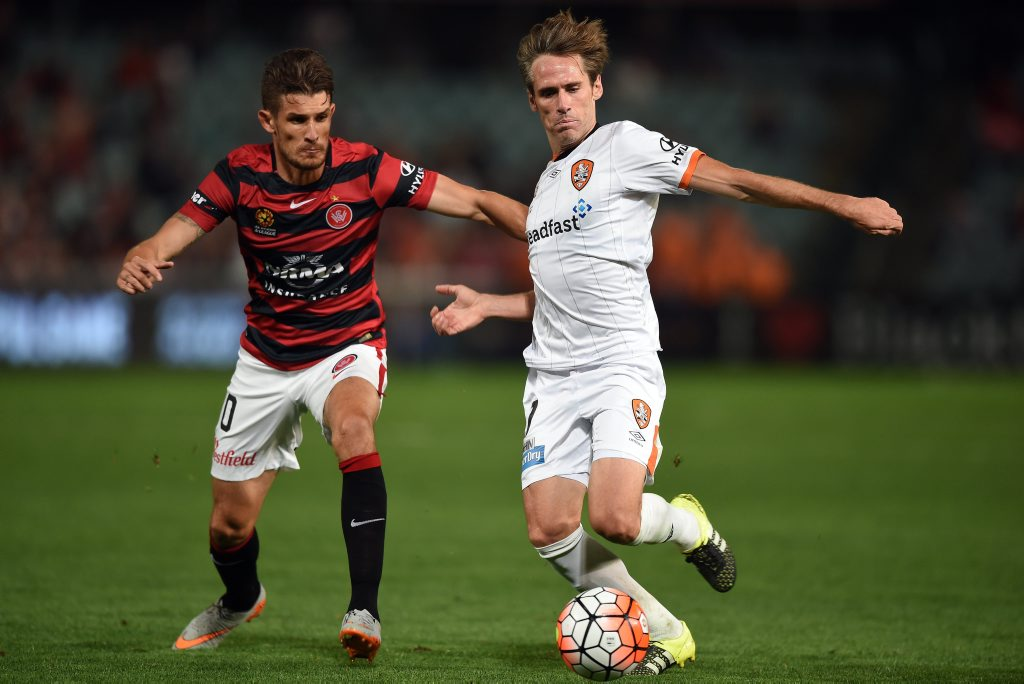 Corona (right) of the Roar is tackled by Dario Vidosic of the Wanderers during the round 1 A-League match between the Western Sydney Wanderers and the Brisbane Roar at Pirtek Stadium in Sydney on Thursday, Oct. 8, 2015. (AAP Image/Paul Miller) NO ARCHIVING, EDITORIAL USE ONLY
