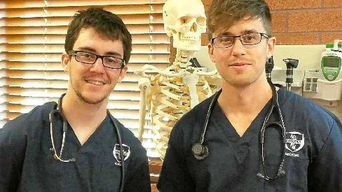 HUMANITARIAN AID: Local medical students Tom Boland and Shae Tripp are going to volunteer in Laos. Photo: contributed