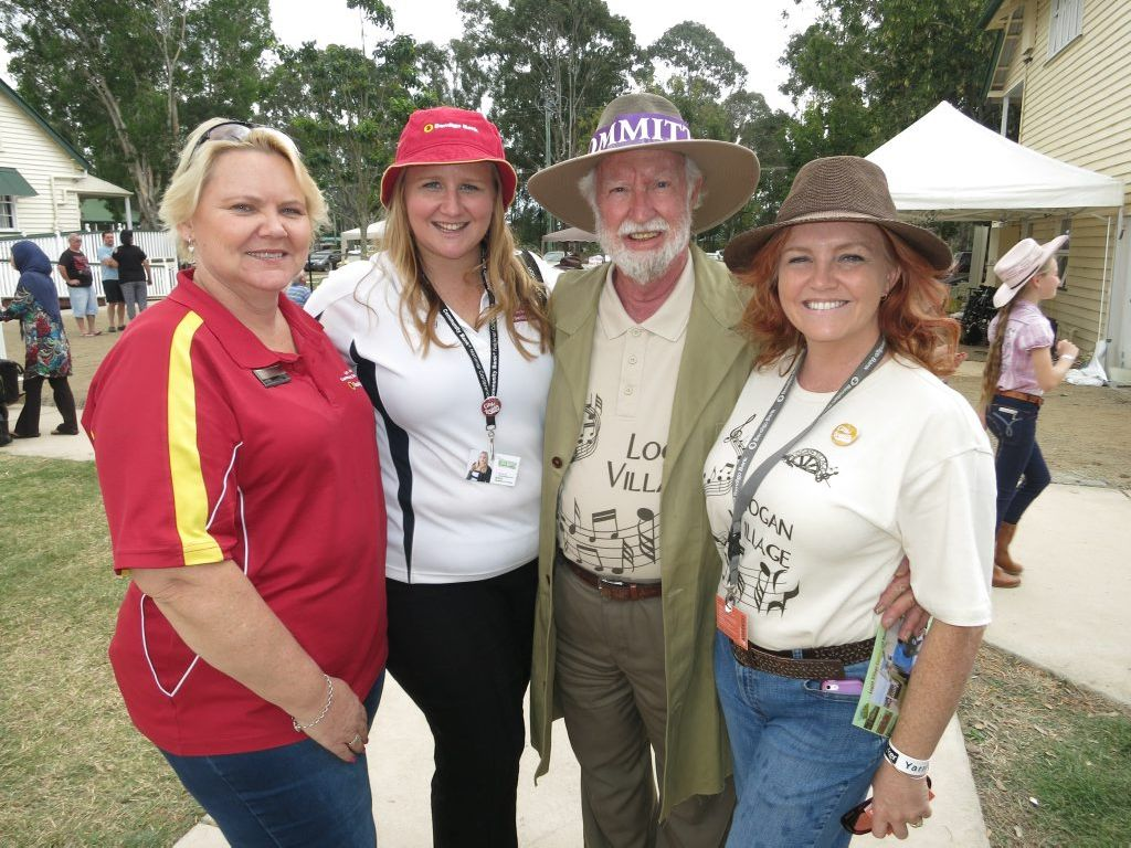 Active 83-year-old Allan Pettigrew enjoys the attention of Bendigo Bank's Stacey McIntosh, Laurie Koranski, and Kerry Menck at the Logan Village music and heritage festival.