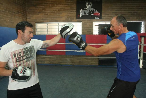 Weather presenter Garry Youngberry trains with Ty Gilchrist from Bribie Island Boxing Club. Photo Vicki Wood / Caboolture News