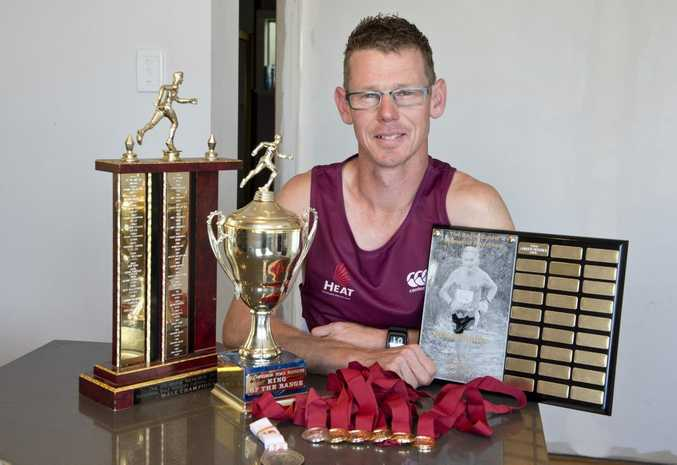 Matt Macdonald with some of the spoils from his successful return to competitive running this year.