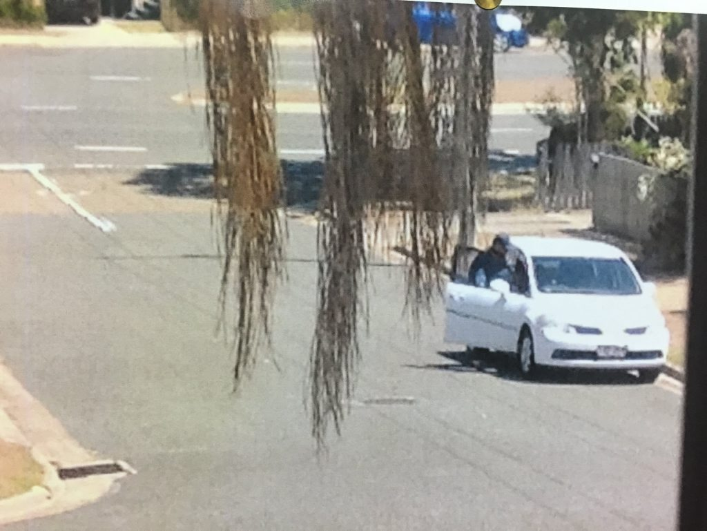 Police would like to know who the men are in this Nissan hatchback. Photo Campbell Gellie / The Observer
