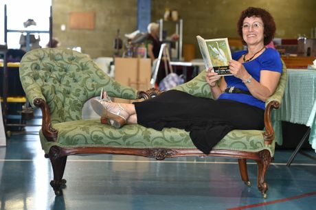 Antique Retro Collectable Fair in the main pavilion at the Maryborough Showgrounds - Anita Pitchag from the Gold Coast relaxes in a Victorian walnut double ended settee with a 1950's Tuckfields Bird Card Album. Photo: Alistair Brightman / Fraser Coast Chronicle