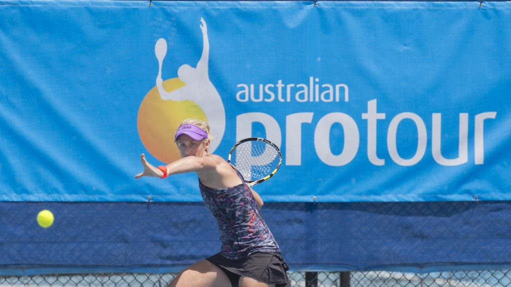 Australia's Jessica Moore prepares to fire back a forehand shot against Japan's Eir Hozumi during their Hutchinson Builders Toowoomba International quarter-final match today.