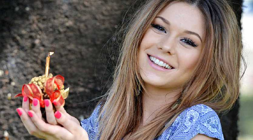 HAPPY BIRTHDAY: Gympie singer Caitlyn Shadbolt is in the mood to celebrate Gympie's birthday today.