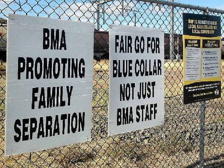 FAIR GO: Signs have been erected around Blackwater, after negotiations for BHP Billiton's next enterprise agreement started on Thursday.