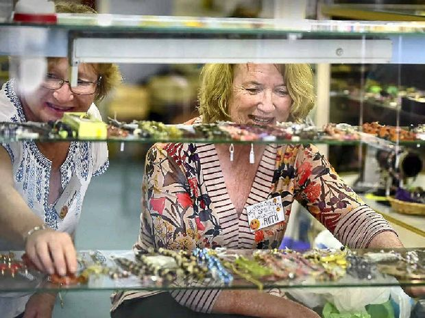 SHOPPING LIST: Elaine Doyle and Ruth Goodchild at the Helping Children Smile op shop, one of nine op shops in Nambour.