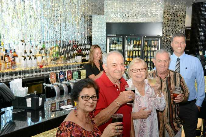 BOTTOMS UP: Maureen and John Rushbrook, and Janice and Ray Amendolia, celebrate Twin Towns refurbishment with Executive Business Manager Rod Pain as Kylie Leeleong prepares a drink. Photo: Daniel McKenzie / Tweed Daily News.