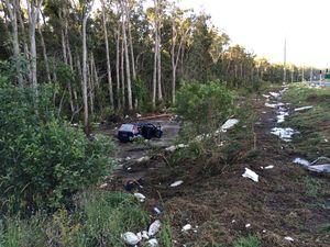 Water tank ruptures and washes car from Kawana Way