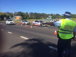 Two killed when car and truck collide on Pacific Highway