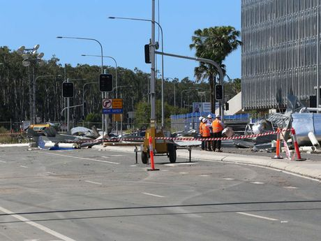 Heavy machinery has been brought in to clear the collapsed tank and debris of Kawana Way.