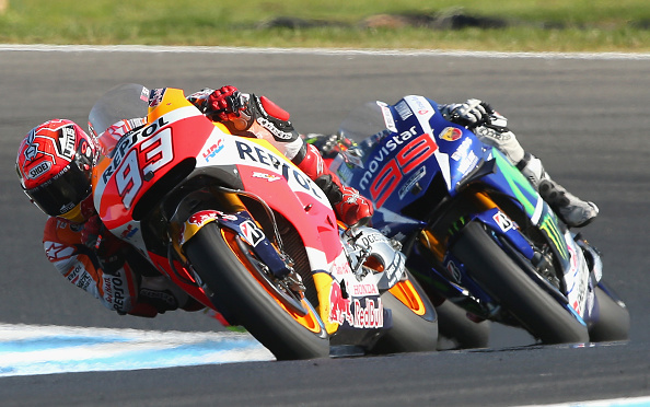 Marc Marquez of Spain and the Repsol Honda team leads Jorge Lorenzo of Spain and Movistar Yamaha MotoGP  at Phillip Island. (Photo by Quinn Rooney/Getty Images)