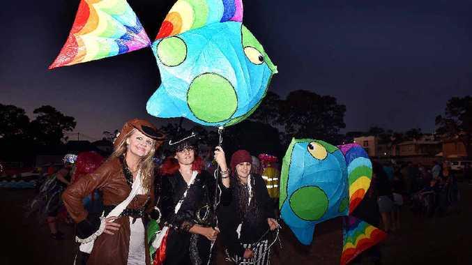 LIGHTING THE WAY: Leading the Hervey Bay Whale Festival Illumination Lantern Parade, Lynda Eggerling, Donna Morgan and Jamin Eggerling.