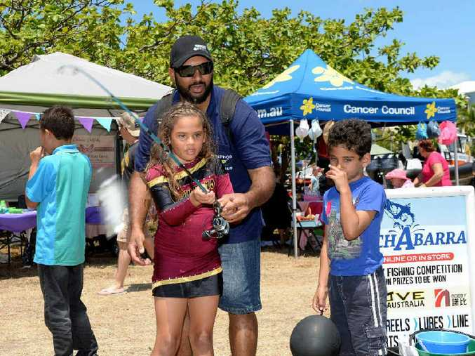 FAMILY FUN: Hera Petrou practices her casting with Leon and Andron Petrou at the 'Catchabarra' stand at the Pink Ribbon Charity Fair.