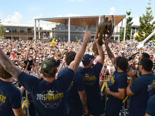 THE COWBOYS ARE MY TEAM: The North Queensland Cowboys including Johnathan Thurston and Matt Scott show off the premiership trophy to Mackay fans at a packed Bluewater Quay yesterday.