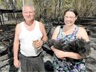 RELIEVED: Despite losing a caravan and the contents of a shipping container to fire, Ross Allan and his daughter Aleisa were happy that they did not lose their home or their pet dogs during a bushfire in the Struck Oil area last year.