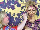VANISHING ACT: Body artist Emma Hack, whose art was featured in Gotye's music video, shows off her skills on stage.