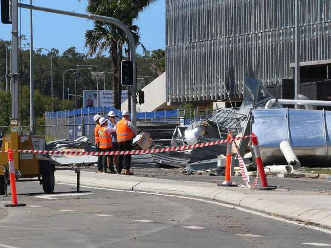 HEAVY LIFTING: Crews were scheduled to work though last night and into today to remove the damaged water tanks at the Sunshine Coast Public University Hospital.