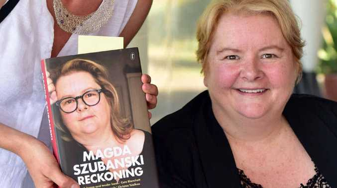 SIGNED BY THE AUTHOR: Coolum resident Anna Corboy grabs a copy of Magda Szubanski's book, Reckoning: A Memoir.