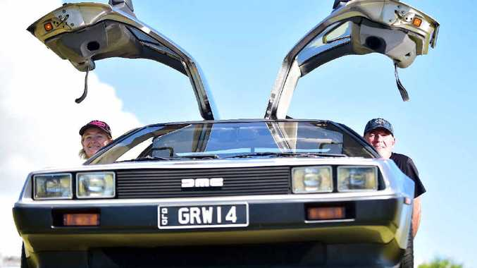ICONIC CAR: Greg and Debbie Waters with their DeLorean sports car, made famous in the 1980s Back To The Future movie trilogy.