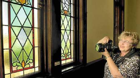 WONDERFUL: Lyn Wetzig enjoys the stained glass windows at St David's Presbyterian Church.