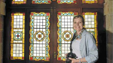 STUNNING WINDOWS: Eleanor Knie of Toowoomba looks around in Clifford House which was open to the public during Open House.