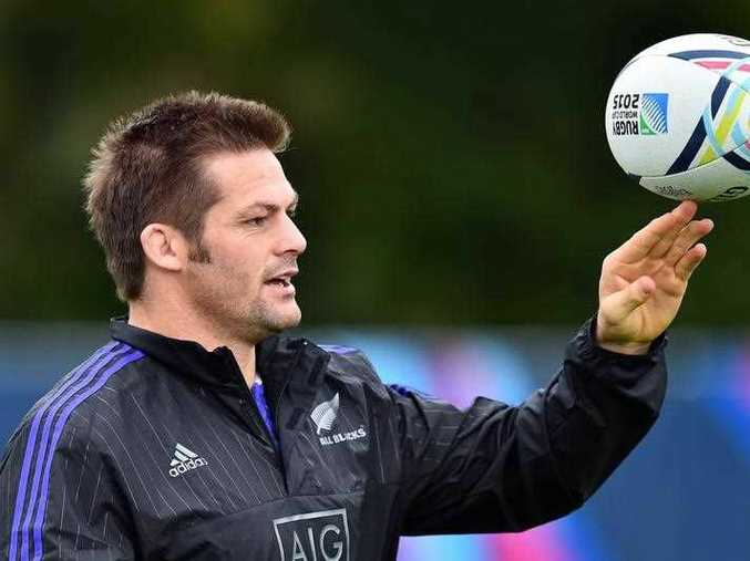 New Zealand All Blacks' flanker and captain Richie McCaw plays with the ball during a training session at the Lensbury Hotel in Teddington, south-west London, on September 16, 2015, ahead of the 2015 Rugby Union World Cup, which begins on September 18.