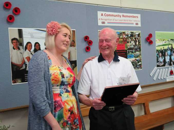 War veteran 97 year old Jack Bell receives a drawing portrait of himself from Hayley Anderson at the Evans Head Living Museum