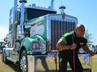 Derek Boyer muscles up to pull Dawson Transport's Kenworth. Photo David Vile / Big Rigs