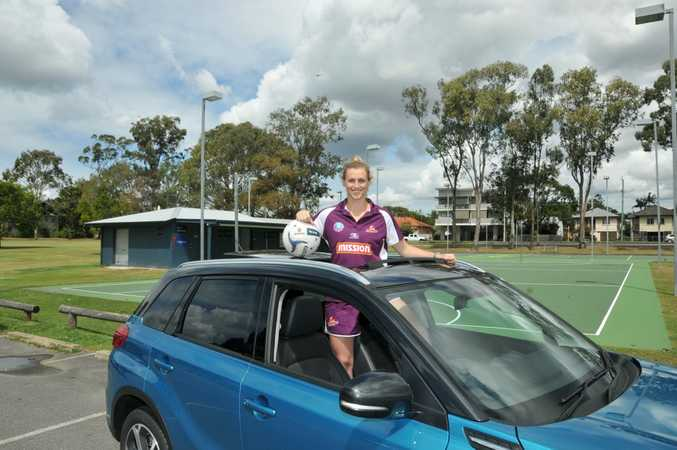 Netball player Gabi Simpson with her Suzuki Vitara. Photo: Contributed