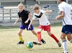 FUN: Nutmeggers' Orik Mikkelsen playing at yesterday's The Reagan Milstein Foundation Community Football Day and (below) the Kawungan Sandy Straits.