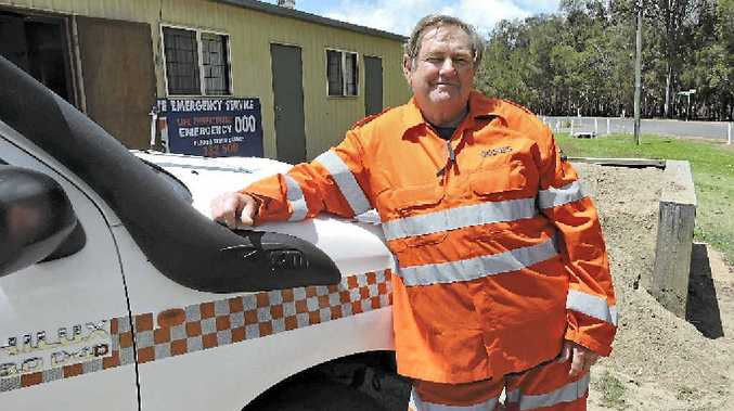 LOCAL HERO: Sandy Strait SES team coordinator Ian McGeachin stands in front of the Boonooroo SES shed, where he spends his time volunteering to keep the region safe.