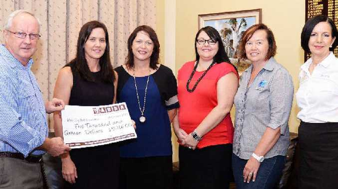 John Croaker, Melissa Hytch, Deb Hughes, Any Heironymus, Tracy Watt and Vicki Deller with a donation to the Black Dog Ball.
