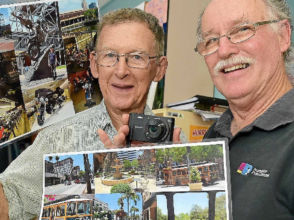 SNAP HAPPY: Peter Rosendale (right) is lucky to have his camera returned by Greg Pitman after he left it in a store while holidaying in America.