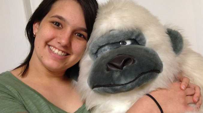 GARAGE GORILLA: Samantha Kohl snuggles up with family favourite Gorr Rilla. He's a great ape, but he only joined the Grey troop after a garage sale triumph of haggling and timing.