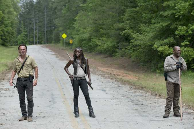 Andrew Lincoln, Danai Gurira and Lennie James in a scene from The Walking Dead. Supplied by Foxtel. Please credit photo to Gene Page/AMC.