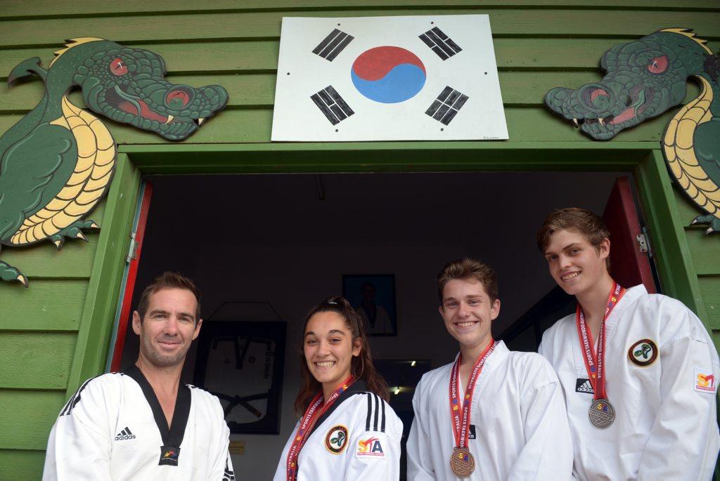 MEDAL HAUL: ASP Taekwondo head instructor Tim Annett, Jess Borg, Cody Ey and Elijah Tandy recently returned from 2015 Australian National Championships. Photo: Max Fleet / NewsMail