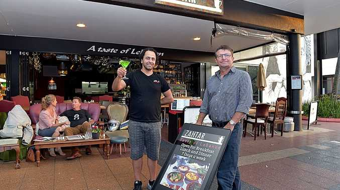 David Ranger from Wayo has developed a digital mobile sign. David shows off the sign to George Bon Mansour (left) from Zahtar Restaurant, Maroochydore.