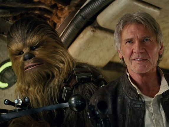 Peter Mayhew (as Chewbacca) and Harrison Ford in a scene from the movie Star Wars: The Force Awakens. Photo by Lucas Films, supplied by Disney.