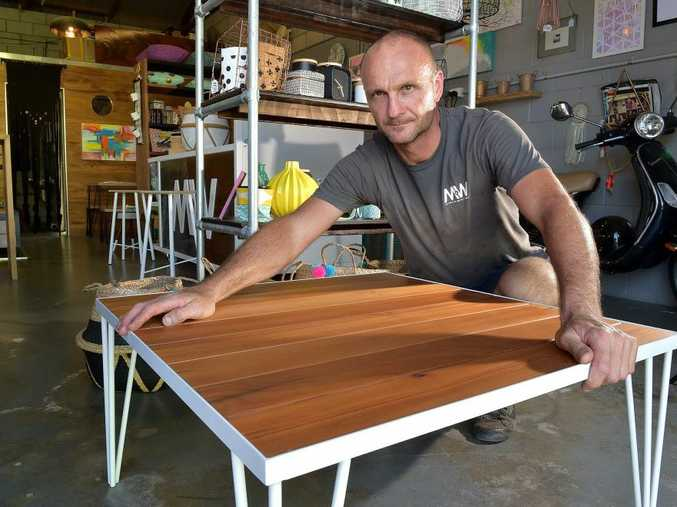 Paulo (Paul) Baretta from Things of Metal and Wood shows the coffee table he made. Photo: Warren Lynam / Sunshine Coast Daily