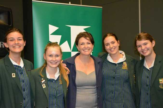 The Sunshine Coast Grammar Year 12 team with their coach and Teacher in Charge of Debating Mrs Meg Dunstan