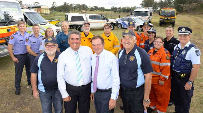 IN THE RUNNING: Rotary Ipswich North's Michael Byrne (left) and Richard Horne with local mayors Paul Pisasale and Graeme Lehmann, and some of the region's emergency services personnel.