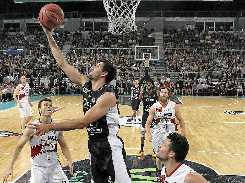 ON FIRE: Todd Blanchfield playing for his new team, Melbourne United, against the Illawarra Hawks. The Mackay player will face his old team, the Townsville Crocodiles, tonight in round three of the NBL.